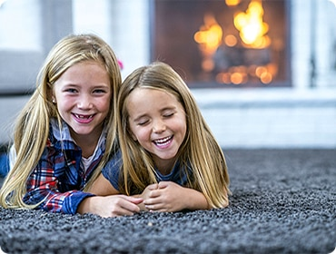 kids laying on clean carpet