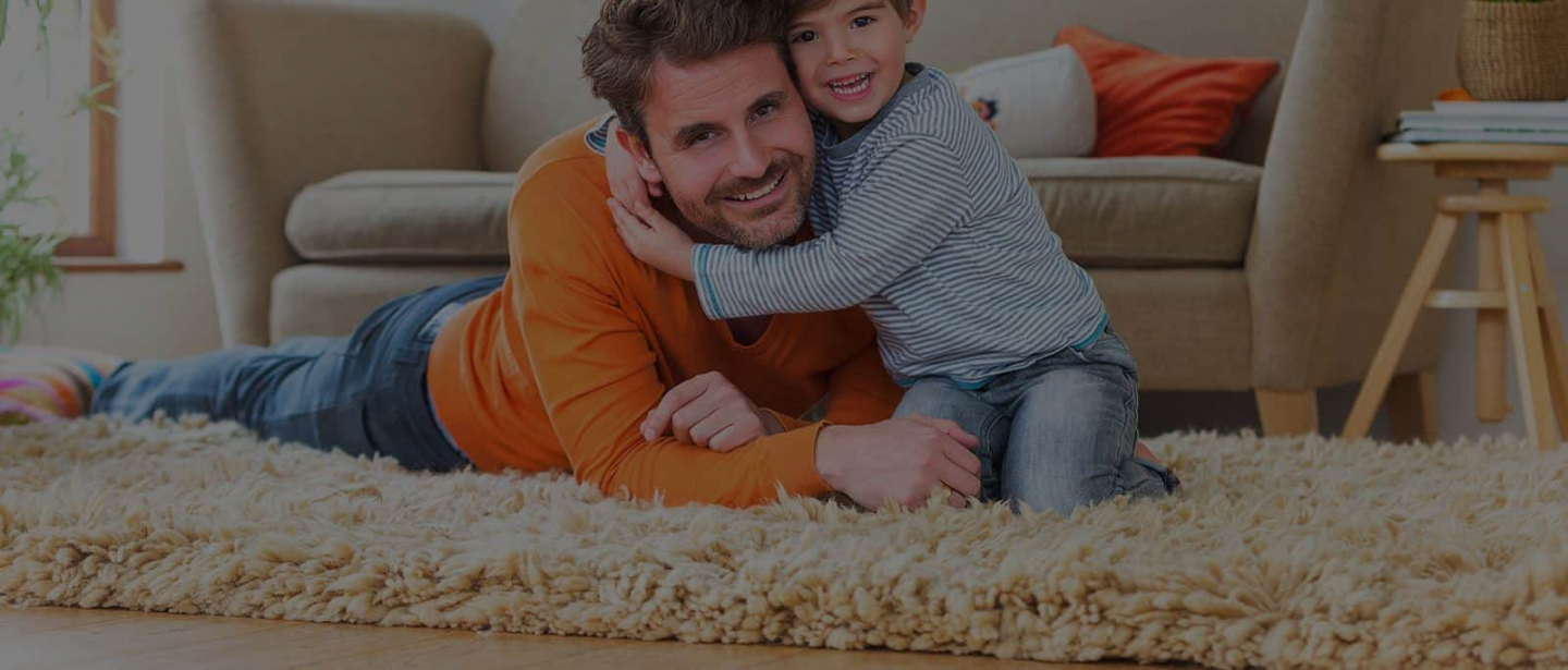 Family laying on clean rugs