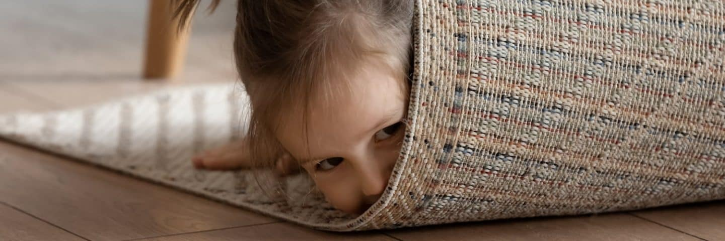 Girl wrapped in clean rug