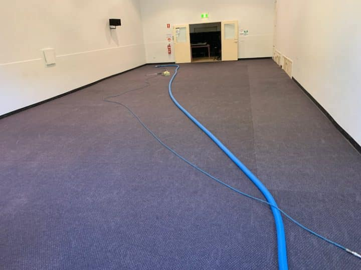 commercial carpeted floor about to be professionally cleaned
